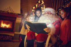 Santa Claus reading magic Christmas fairy tale